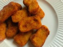 Chicken nuggets on a plate royalty free stock photos