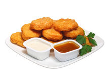 Chicken nuggets in plate with two dressings Royalty Free Stock Images