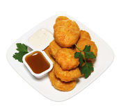 Chicken nuggets in plate with two dressings Royalty Free Stock Photography