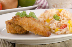 Chicken nuggets with rice salad Royalty Free Stock Image