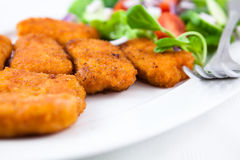 Chicken nuggets with salad Royalty Free Stock Image