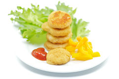 Chicken Nuggets with salad leaves and bell pepper. Isolated on white Royalty Free Stock Images