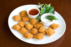 Chicken nuggets with sauce Stock Images