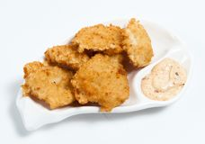 Chicken nuggets with sauce on the plate Stock Photography