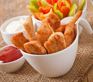 Chicken nuggets with sauce and vegetables Royalty Free Stock Images