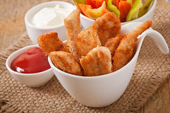 Chicken nuggets with sauce and vegetables Royalty Free Stock Photos