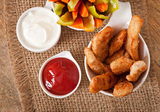 Chicken nuggets with sauce and vegetables Stock Image