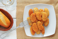 Chicken nuggets served in a white bowl, top view Royalty Free Stock Photo
