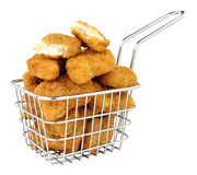 Chicken Nuggets In A Small Wire Frying Basket. Breadcrumb covered chicken nuggets in a small wire frying basket isolated on a white background royalty free stock images