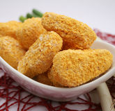 Chicken nuggets. Some fresh chicken nuggets in a bowl Stock Images