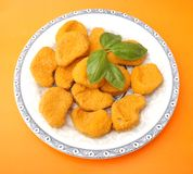 Chicken nuggets. Some fresh chicken nuggets on a plate Royalty Free Stock Images