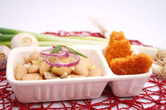 Chicken nuggets. Some fresh chicken nuggets with a salad of beans Royalty Free Stock Photo
