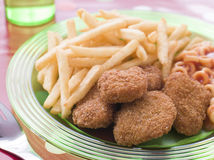 Chicken Nuggets with Spaghetti Hoops and Chips Stock Images