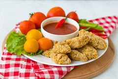 Chicken nuggets with tomato sauce.  Stock Photo