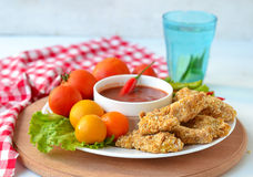 Chicken nuggets with tomato sauce.  Stock Photography
