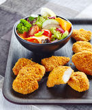 Chicken nuggets and vegetable salad Stock Photo