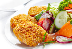 Chicken nuggets and vegetable salad Royalty Free Stock Images