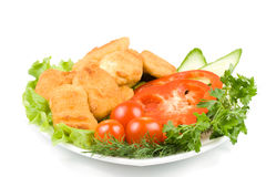 Chicken nuggets with vegetables Royalty Free Stock Photos