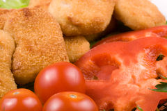 Chicken nuggets with vegetables Royalty Free Stock Image