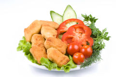 Chicken nuggets with vegetables Stock Images
