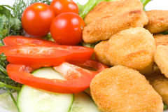 Chicken nuggets with vegetables Stock Photo