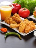 Chicken nuggets. On white plate stock photography