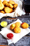 Chicken nuggets on wood background Stock Images