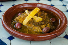 Chicken with olives and lemon. Prepared in traditional Moroccan tajine dish Stock Photography