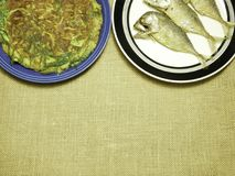 Chicken omelet with local herb and thai mackerel fried on plate. Chicken omelet with local herb Stock Photos