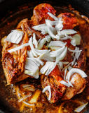 Chicken with onion on frying pan Royalty Free Stock Photography