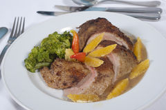Chicken and orange a la carte meal. Main meal of chicken and orange a la carte in a restaurant stock photos