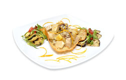 Chicken with orange sauce. And grilled vegetables Stock Photos