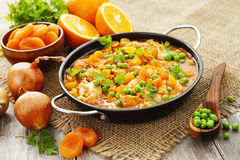 Chicken with oranges stock photography