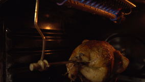 The chicken in the oven roasting on a spit. stock video