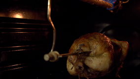 The chicken in the oven roasting on a spit. stock video footage