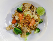 Chicken pad Thai dish of stir fried rice noodles. At Thai local restaurant royalty free stock image