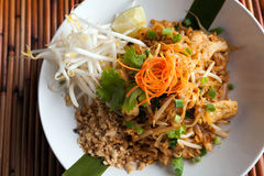 Chicken Pad Thai Top Down. Chicken pad Thai dish of stir fried rice noodles with a contemporary presentation Stock Images