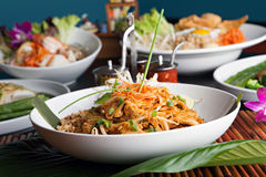 Chicken Pad Thai. With a variety of other fine Thai food dishes.  Shallow depth of field Stock Image