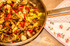 Chicken pan. Pan with colorful vegetable and chicken Stock Photo