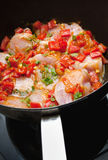 Chicken pan fry with red peppers Stock Photography