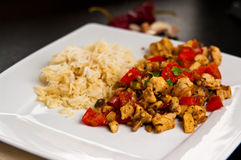 Chicken with paprika rice and curry dish Royalty Free Stock Image