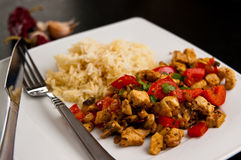Chicken with paprika rice and curry dish Royalty Free Stock Photo