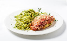 Chicken with parmesan cheese and linguine pasta in pesto sauce. On white background. Close-up Royalty Free Stock Image