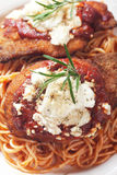 Chicken parmesan with spaghetti pasta. Chicken parmesan, breaded chicken steak with tomato sauce and spaghetti pasta Royalty Free Stock Photography