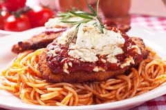 Chicken parmesan with spaghetti pasta. Chicken parmesan, breaded chicken steak with tomato sauce and spaghetti pasta Stock Photography