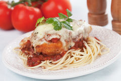 Chicken parmesan with spaghetti pasta. Chicken parmesan with melted cheese and tomato sauce served over spaghetti pasta Royalty Free Stock Images
