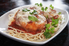 Chicken parmesan with spaghetti pasta. Chicken parmesan with melted cheese and tomato sauce served over spaghetti pasta Royalty Free Stock Photo