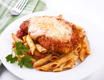 Chicken parmigiana. Served on top of pasta with marinara sauce Stock Images