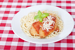 Chicken parmigiana. On a white plate with spaghetti Royalty Free Stock Images