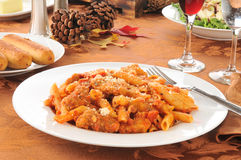 Chicken parmigiana and penne Stock Image